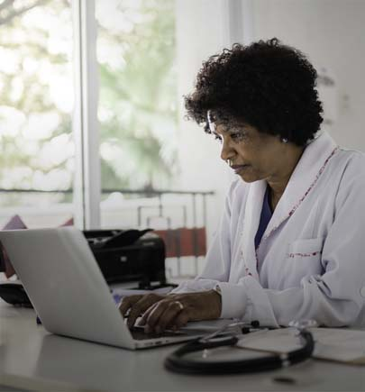African origin healthcare worker working at her desk