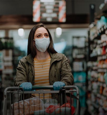 woman wearing mask, shopping in grocery store