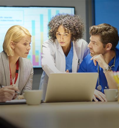 three healthcare personnel discussing
