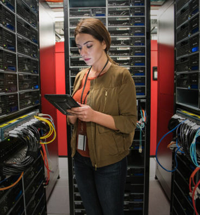 Woman working in a server room