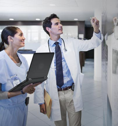 healthcare epic consulting - doctor and nurse looking at reports