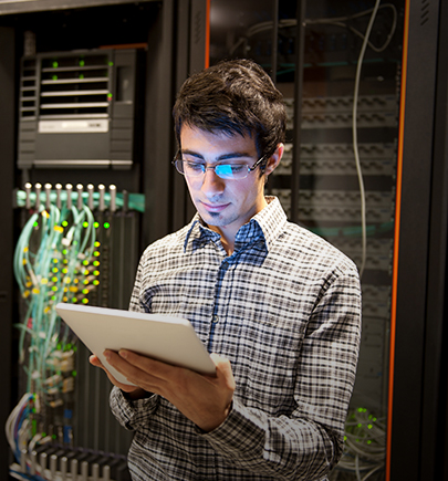 person with tablet in server room