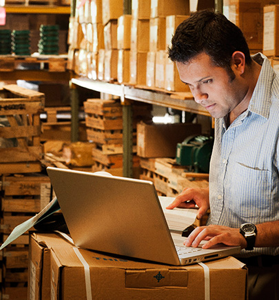 warehouse manager with laptop
