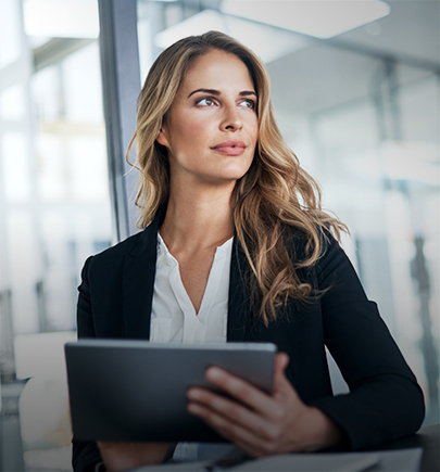 woman in suit holding a tablet