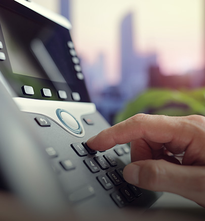 dialing-on-a-deskphone-closeup