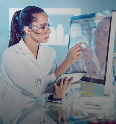 lady in lab working on computer and tablet pc