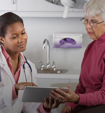 doctor with patient looking at tablet