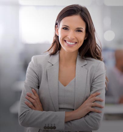 lady in grey suit smiling while folding handing
