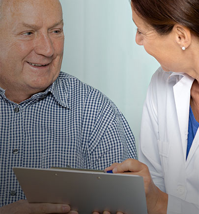 doctor with old age patient along with notepad