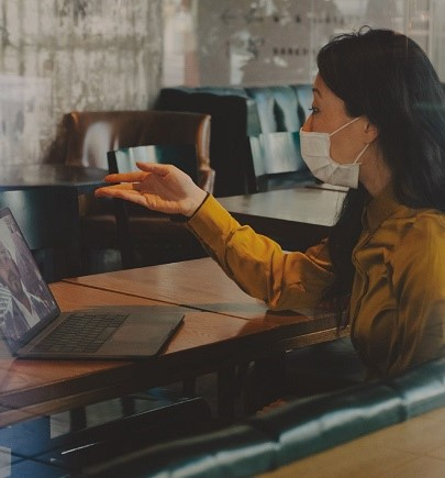woman wearing mark and in virtual meeting