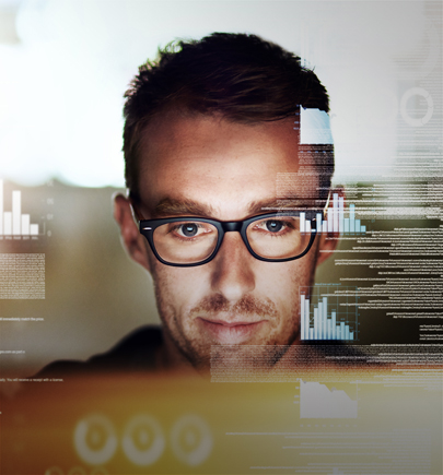 Man in glasses working on computer