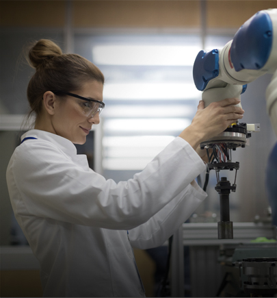 Female lab tech with robot