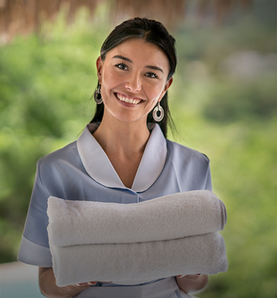 female housekeeping staff smiling
