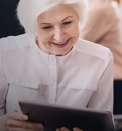 Elderly woman viewing tablet