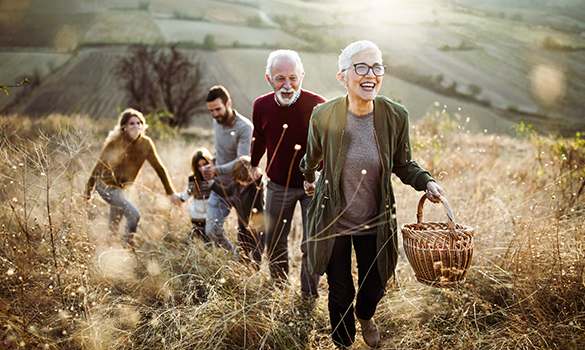 1 old couple and 1 young couple with kid in field
