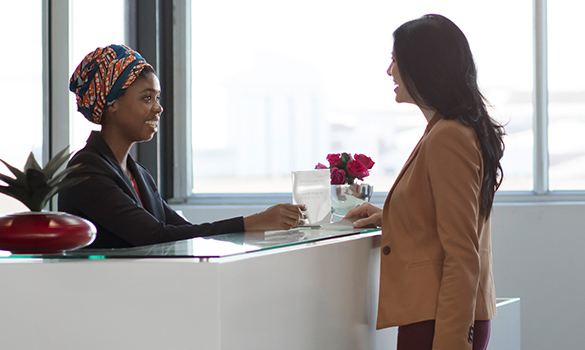 female executive at office reception counter