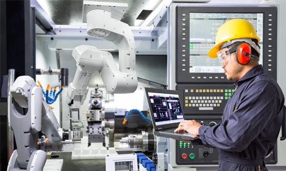 man wearing safety helmet, safety glasses and hearing protection headset and working with robot