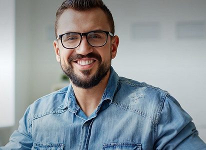 man wearing glasses smiling