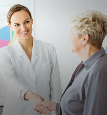 Female clinician with a mature woman