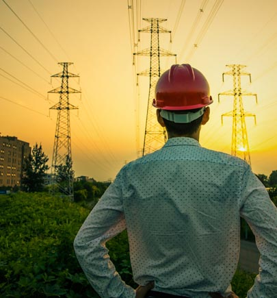 Engineer looking at electrical towers