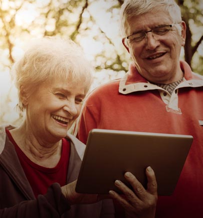 Happy senior couple viewing a tablet