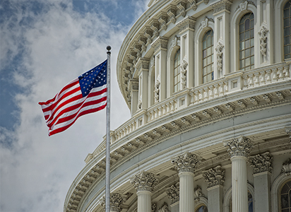 American flag flies outside the U.S. Capitol building