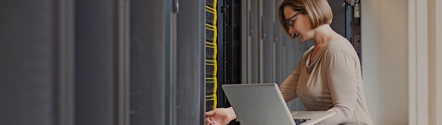 woman with laptop in data center