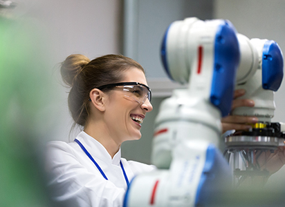 Smiling technician working in a lab