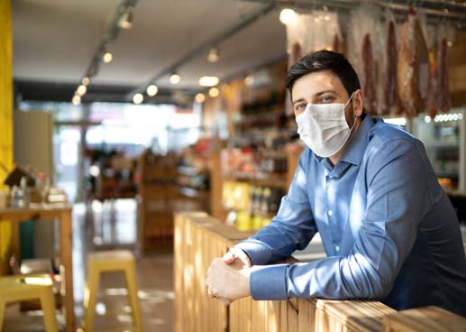 Portrait of small business man owner with face mask